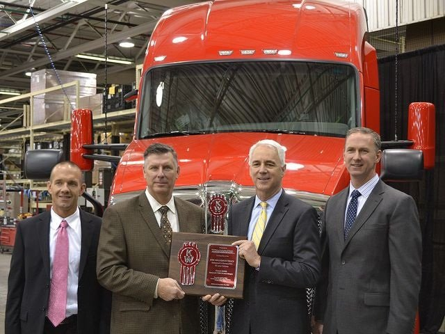 From left are TransAm Trucking's Murray Droescher (chief financial officer) and Russ McElliott (president); Gary Moore, Kenworth general manager and PACCAR vice president; and Preston Feight, Kenworth assistant general manager for sales and marketing: Photo via Kenworth.