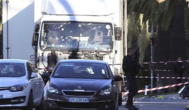 Truck used to kill pedestrians in Nice, France on July 14, shown after the driver was killed by police gunfire. Image via Twitter