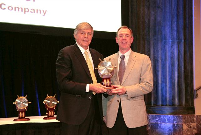 Gary Palmer (right) of True Value Co. receives the Private Fleet Executive of the Year award from Gary Petty, NPTC's president and CEO.