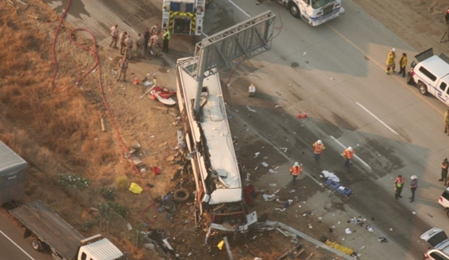 Aerial view shows motorcoach at final rest and impact damage caused by signpost penetrating two-thirds of vehicle. Photo: California Highway Patrol