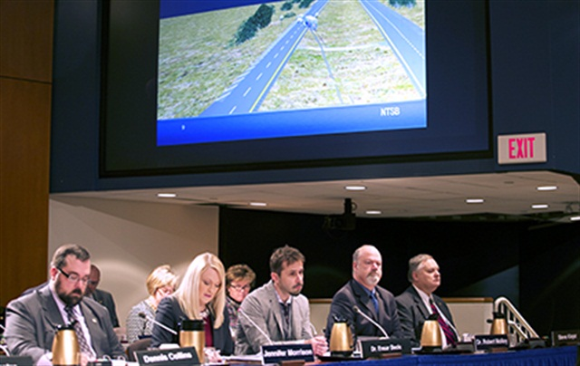 NTSBInvestigator-in-Charge Jennifer Morrison shows the Board reenactment animation of collision between tractor-trailer truck and bus in Davis, Okla., on September 26, 2014. Photo: NTSB