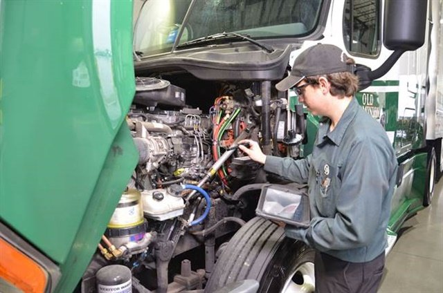 An Old Dominion Freight Line service center technician checks diagnostics on a tractor engine. Photo: ODFL