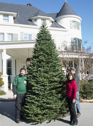 Karen Pence (right) poses with Old Dominion driver Preston after taking delivery of the official Christmas trees for the Vice President's residence.