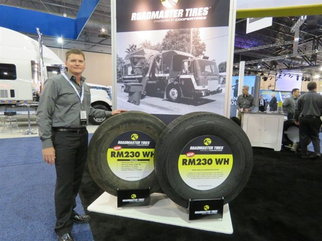 Cooper Tire's Gary Schroeder bythe Roadmaster displayat the ATA's Management Conference and Exhibition. Photo: David Cullen