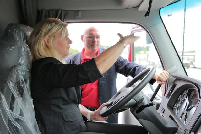 Ellen Voie, President and CEO of Women In Trucking, checking out new cab ergonomic specifications. Photo courtesy of Ryder System