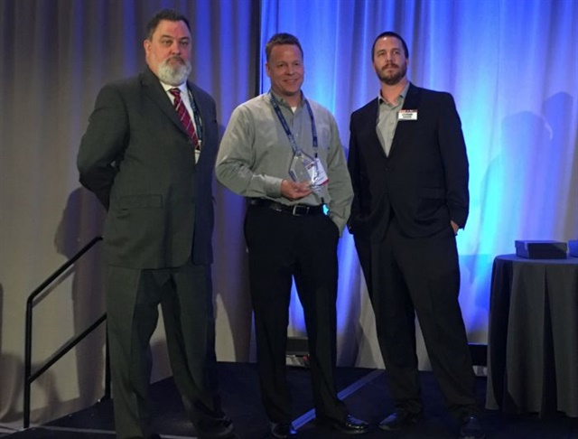 Rich Wilson (left), Omnitracs' senior sales manager; Ken Marvenko, director of safety and driver development at Paper Transport, with his Safety and Compliance Award; and Stephane Babcock, managing editor of Heavy Duty Trucking at the Fleet Safety Conference. Photo: Andy Lundin