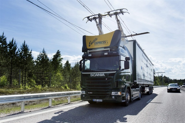 This Scania Class 8 tractor can run on conventional diesel power, or connect to overhead wires and run on electric power at highway speeds. Photo: Scania