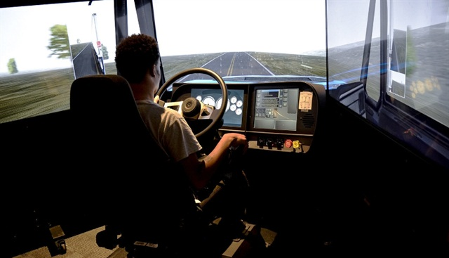 Celadon Driving Academy student Drew Davis practices his driving skill on the TransSim VS6 driving simulator. (PRNewsFoto/Celadon Trucking)
