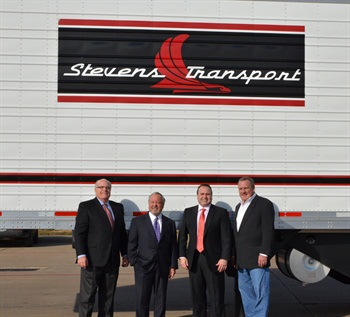 Celebrating the 100,000th trailer, from left to right: Dave Wallace, Utility Trailer Manufacturing Co.; Steve Aaron, Stevens Transport chairman and CEO; Clay Aaron, Stevens Transport president; and Packy Watson, Utility Trailer of Dallas.