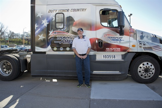 Transport America recognizes one of their drivers and military veteran, Robert Harp, on Veteran's Day with a custom military truck wrap. Photo: Transport America