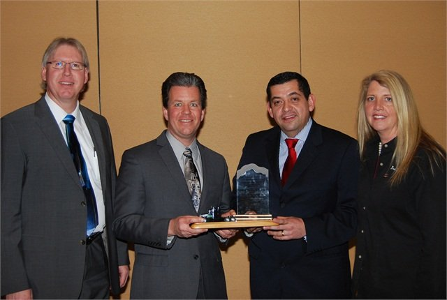 "Wabco Reman Solutions was named the ""Heavy Duty Remanufacturer of the Year"" Award winner by the Heavy Duty Remanufacturing Group. Accepting the award from Sandra Standley, right, chairman of HDRG, is a team from Wabco Reman Solutions, including (left to right) Joe Kripli, Global Business Development Leader; Jeffrey Stukenborg, Chief Engineer; and Salvador Munoz, Reman Business Leader."