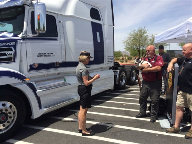 "Western Star president Kelley Platt presents OOIDA spokesman Jon Osborn the keys to ""Snowflake,"" his new 5700EX touring truck."