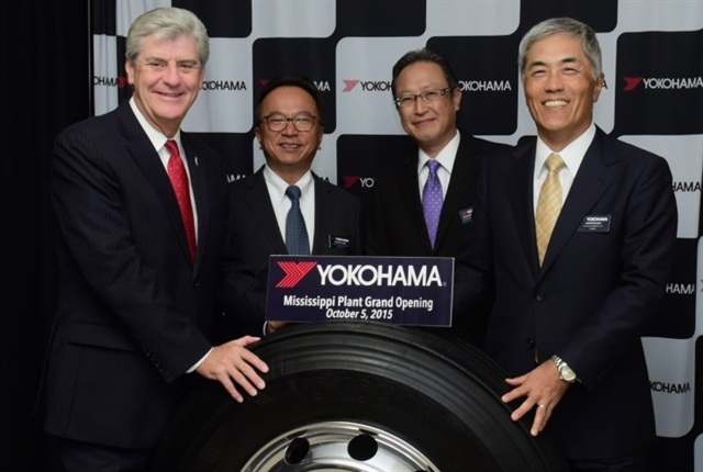 Mississippi Gov. Phil Bryant, Takaharu Fushimi, CEO of Yokohama Corp. of North America & Yokohama Tire Corp., Tadaharu Yamamoto, president of YTMM, and Hikomitsu Noji, president of Yokohama Rubber Co., Ltd., pose with the first tire produced at the company's new U.S. plant. Photo: Yokohama