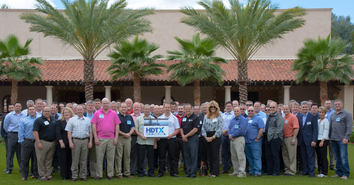 The more than 80 attendees of the inagural Heavy Duty Trucking Exchange were all smiles during...