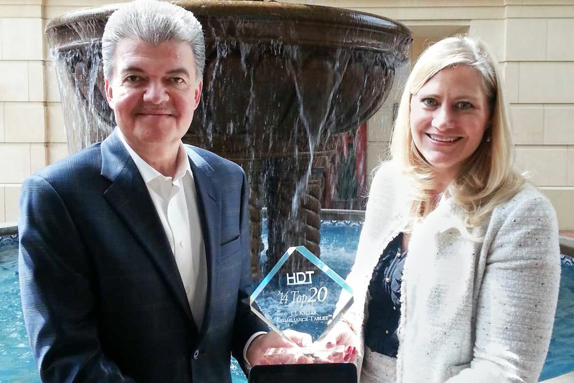 Heavy Duty Trucking Publisher David Moniz presents Top 20 award to J.J. Keller President Marne...