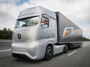 Daimler Trucks head Wolfgang Bernhard at the helm of the concept truck illustrating the...
