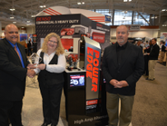 Frank Jenkins, left, senior manager, heavy duty marketing group for Denso, accepts the HDT Top...