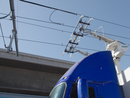 With Siemans' system, the truck driver can raise or lower the pantograph as needed while...
