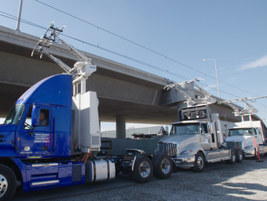 The test trucks feature a retractable overhead pantograph system as well as an electric...