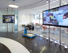 "Eighth floor reception area feaures a ""showcase circle"" with interactive video touchscreen..."