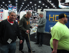 Equipment Editor Jim Park logs a little booth duty on Saturday, Day 3 of the Mid-America...