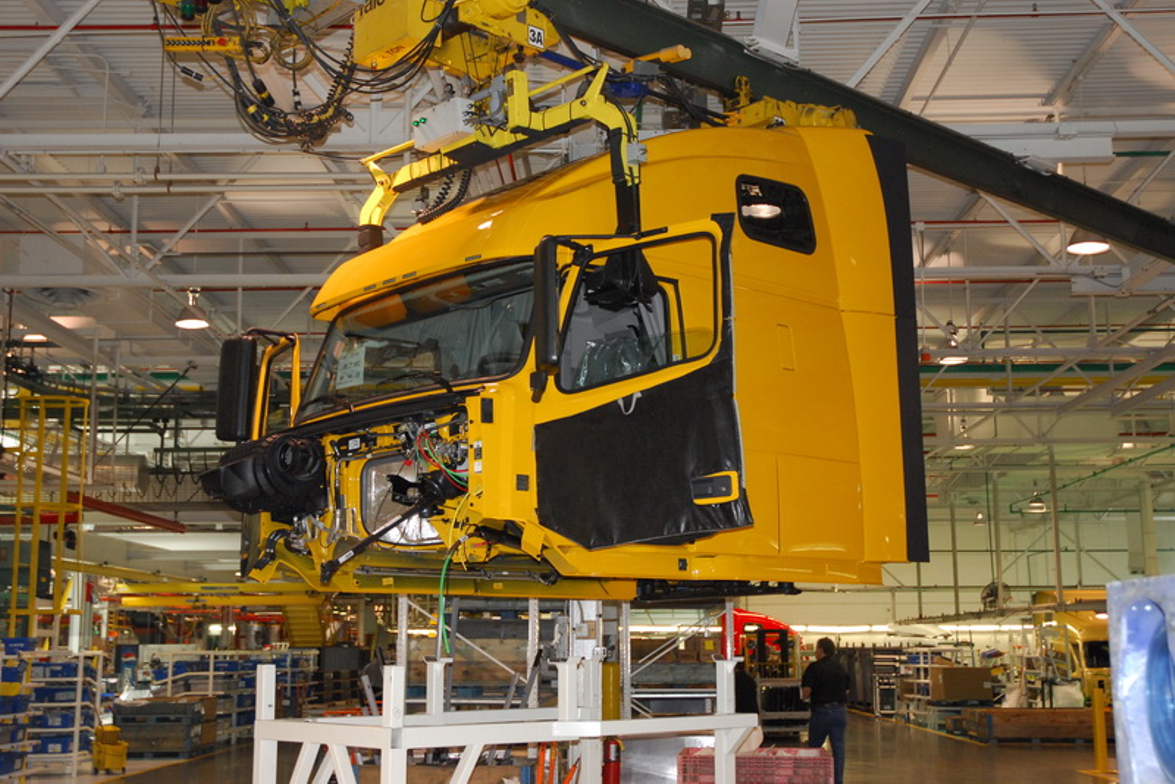 14. At a point where the two assembly lines merge, the cab is hoisted in the air and set gently...