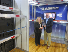 Larry Bethel, president of Ancra Internationa's Cargo Systems Division, accepts the HDT Top 20...