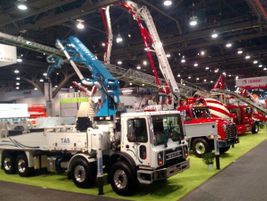 Concrete pumper trucks line aisles of the Las Vegas Convention Center's central hall, where most...