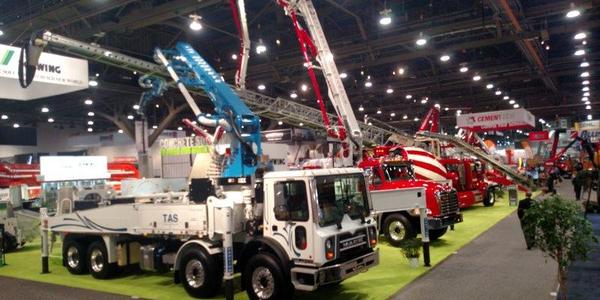 Concrete pumper trucks line aisles of the Las Vegas Convention Center's central hall, where most...