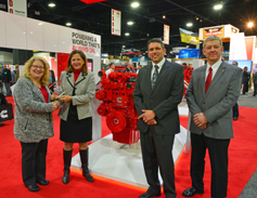 From left, HDT Editor in Chief Deborah Lockridge presents the Top 20 Products award for the...