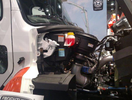 Detroit's new DD8 diesel nestles in a Freightliner 108SD. The 7.7-liter inline 6-cylinder engine...