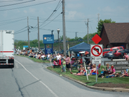 Approximately 6,000 spectators lined the 28-mile route and attended the festival at the business...