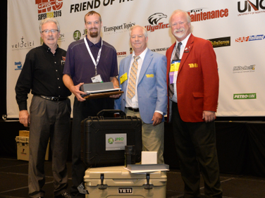 From left: George Arrants, chairman of TMC's technician competition task force; FedEx Freight's...