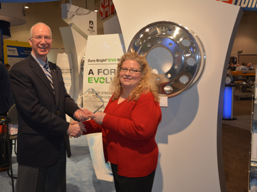 Todd Hershberger, Alcoa VP of sales and marketing for wheel products, accepts the HDT Top 20...
