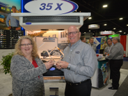 Carrier Transicold southern regional director Scott Williams accepts HDT's Top 20 Products award...
