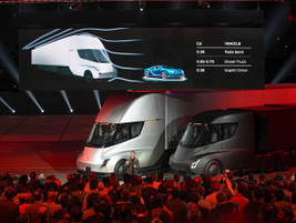The press conference, held at night in Los Angeles, was attended by Tesla fans and journalists...