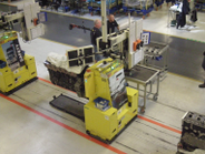 Engines blocks, mounted on automated guided vehicles, making their way to the next station on...