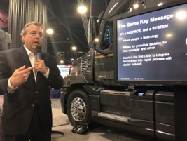David Purdue, Mack Truck's connected vehicle manager, briefs the press on his company's latest...