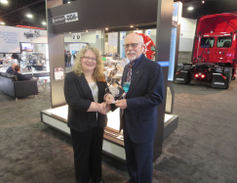 Chuck Blake, national accounts for Detroit, accepts the HDT Top 20 Products award for the...