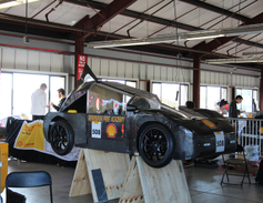 High school teams work on their entries in Shell's Eco-marathon mileage challenge April 20 at...