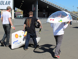 Team members push their entry to the starting line for the Shell Eco-marathon mileage challenge.