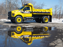 The dump body can haul up to 17,000 pounds.