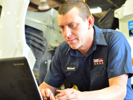 Four Star Freightliner diesel technicians are 100% system certified. Pictured here is diesel...