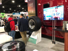A potential customer checks out the Halo automatic tire inflation system at the Aperia...