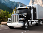 The567 is a vocational truck that looks good in highway service, too. Vertical bars on the...