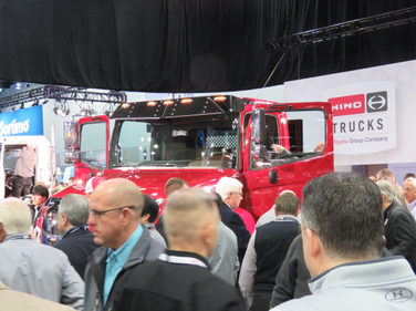 Attendees mob the Hino XL8 after its reveal. Hino said the truck is the first all-new Class 8...
