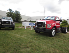 Completed trucks were displayed near the plant's entrance. Production actually began several...