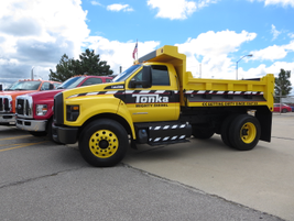 The Tonka Truck-themed F-750 dump is a one-of-a-kind vehicle with graphics approved by the toy...