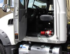 This Granite galvanized steel cab is rugged and roomy. The fuel tank and blue-capped DEF tank...