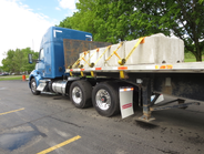 Wide-base single wheels and tires save about 350 pounds over duals. A Meritor FueLite 6x2 tandem...